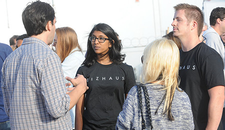 BizHaus Team Members Network with Patrons at an Event